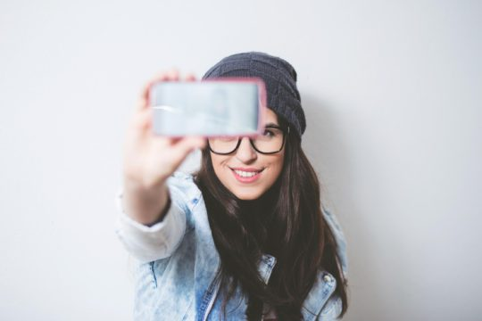 hipster girl taking selfie